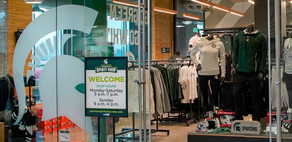 The cover of spring 2019 Serving State shows the front of the Spartan Spirit Shop at 1855 Place.