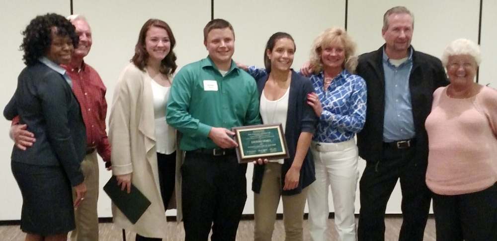 Zachary Perez poses with family as he accepts the MSU Student Employee of the Year award.